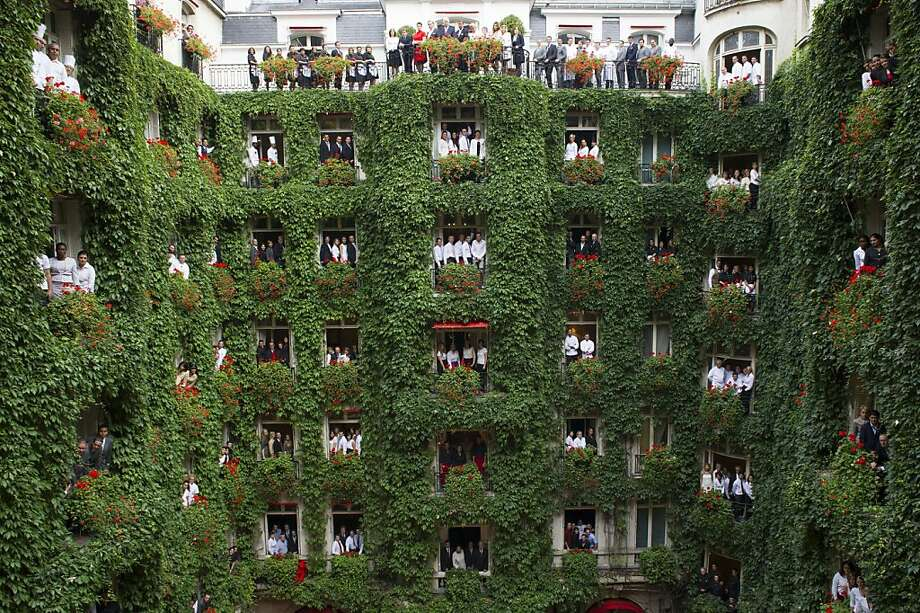Sorry, folks, but we have this ivy problem ... Employees look out onto the atrium of the Plaza Athenee hotel in 