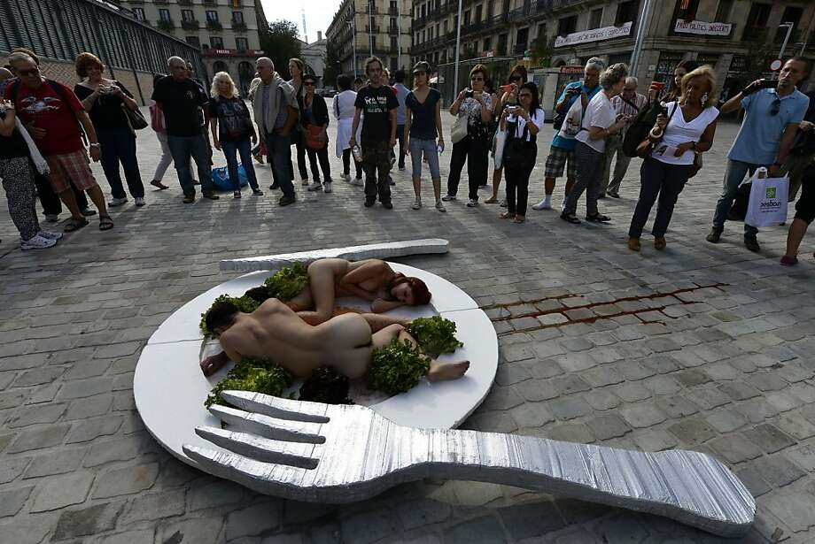 Waiter, there are naked people in my salad:On World Vegetarian Day, activists of the animal-rights group AnimaNaturalis pretend to be an entree in order to persuade people not to eat meat. Photo: Lluis Gene, AFP/Getty Images