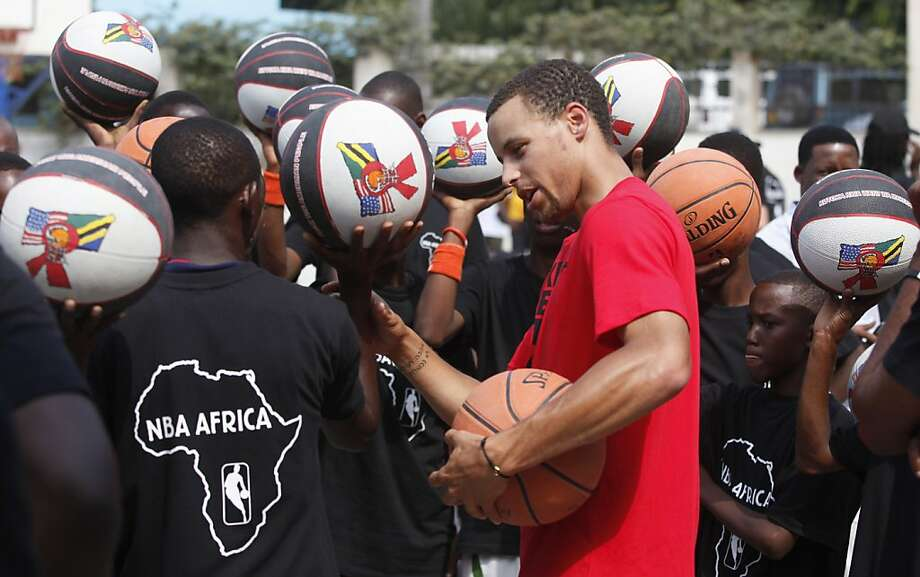 Stephen Curry leads basketball drills during a summer visit to Tanzania, part of an antimalaria campaign. Photo: Stuart Ramson, UN Foundation