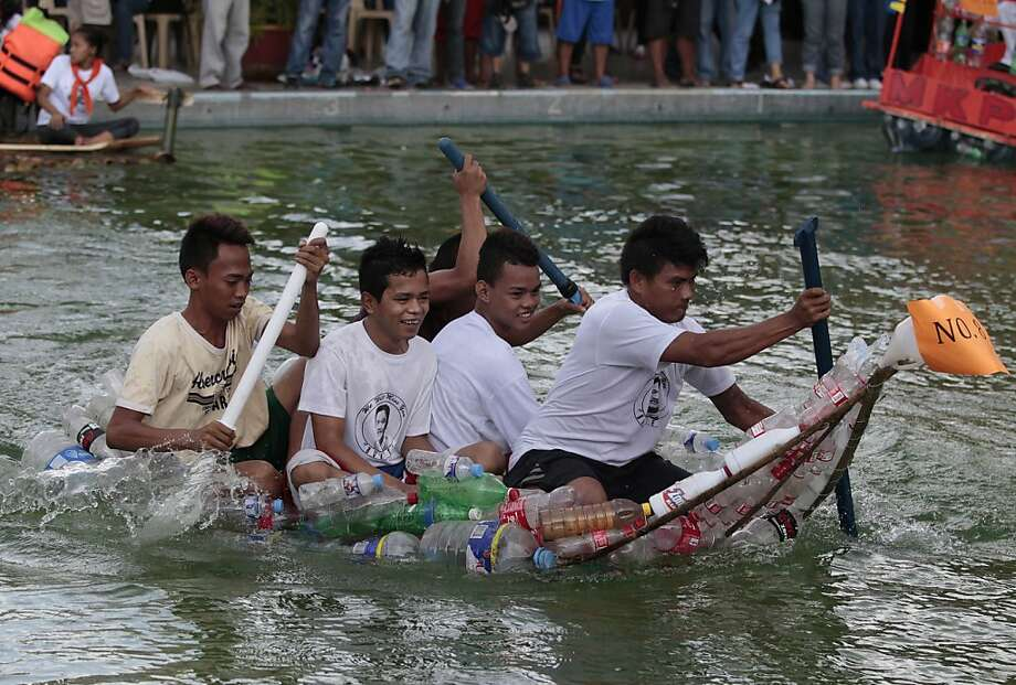 Five men barely stay afloat during a homemade boat race in Manila. The event promoted the use of recycled materials in building boats for emergencies and rescue work in flood-prone areas of the Philippine capital. Photo: Aaron Favila, Associated Press