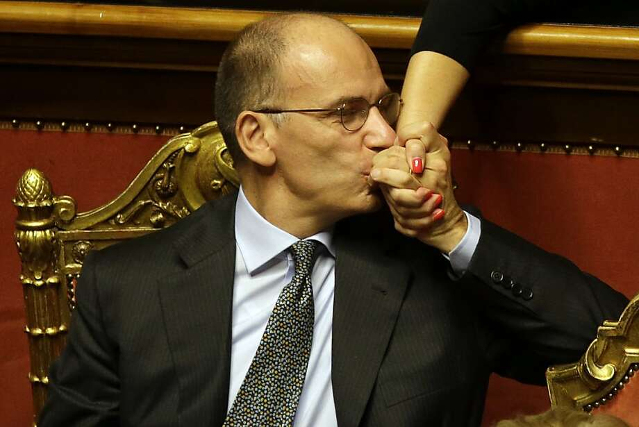 If only Obama and Boehner could get along like this: Italian Premier Enrico Letta kisses the hand of an unidentified senator after delivering a speech in the Senate in Rome. Letta was putting his government's survival to confidence votes in Parliament amid a divisive split in Silvio Berlusconi's party that could at least temporarily save his fragile ruling coalition. Photo: Gregorio Borgia, Associated Press