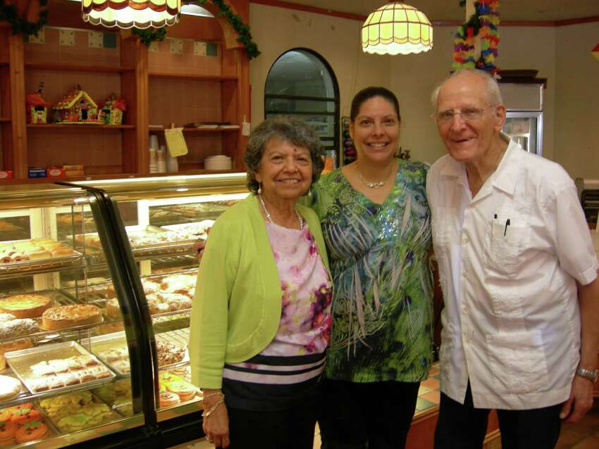 Minerva and Hans Nadler and daughter Alexia Nadler Mendez (center) celebrate the 50th anniversary of Nadler's Bakery & Deli.