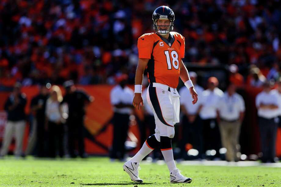 Quarterback Peyton Manning of the Denver Broncos smiles during his game against the Philadelphia Eagles at Sports Authority Field Field at Mile High on September 29, 2013 in Denver, Colorado. Photo: Justin Edmonds, Getty Images / 2013 Getty Images