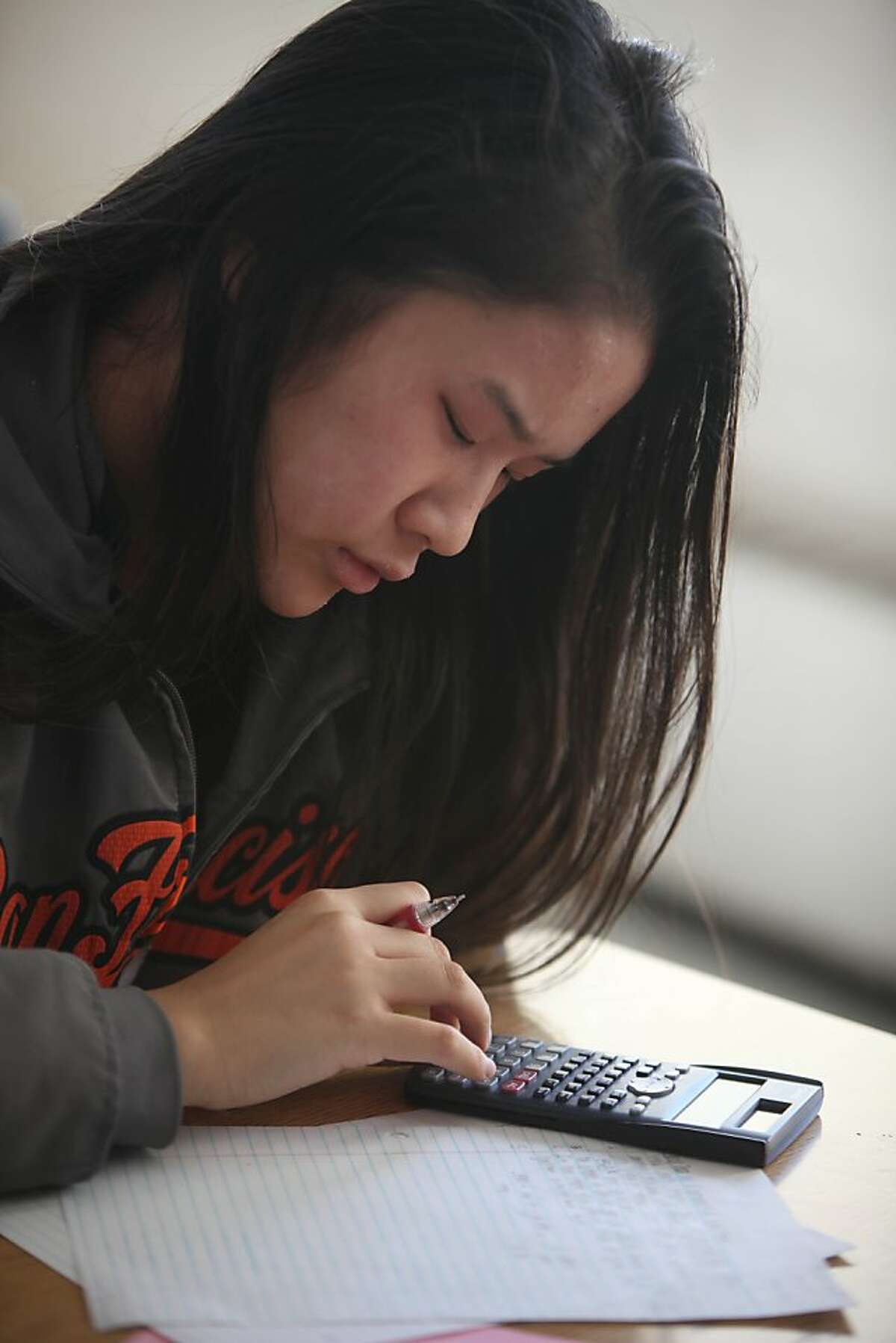Chelsea Nguyen, 15, works on classwork during an Algebra II class at Phillip and Sala Burton Academic High School on Wednesday, October 2, 2013 in San Francisco, Calif.