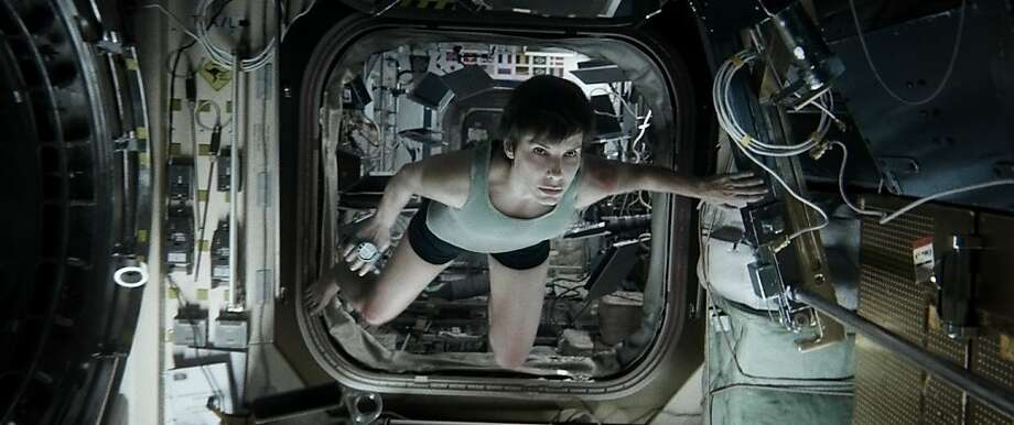 "SANDRA BULLOCK as Ryan Stone in Warner Bros. Pictures' dramatic thriller ""GRAVITY,"" a Warner Bros. Pictures release. Photo: Courtesy Of Warner Bros. Picture, Warner Bros."