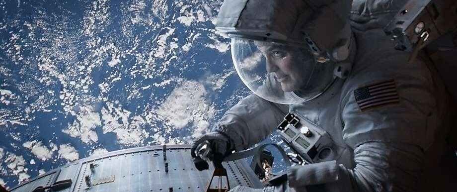 George Clooney amps up his personality to project through his spacesuit. Photo: Courtesy Of Warner Bros. Picture, Warner Bros.