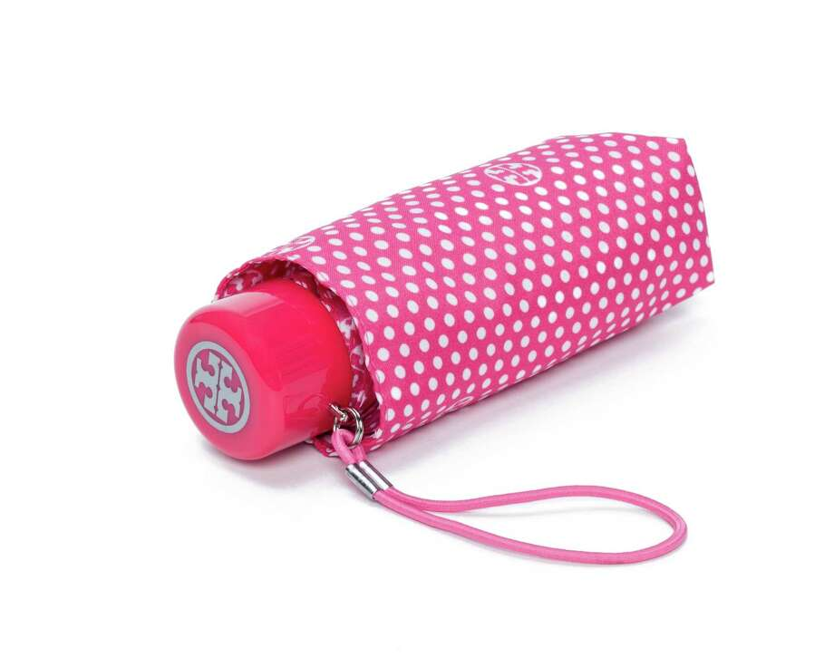 GIMME SHELTERThere's nothing like a dose of bright pink on a rainy day, and this month 20 percent of sales of the Tory Burch mini umbrella support the Breast Cancer Research Foundation, $48 at Tory Burch in the Galleria.