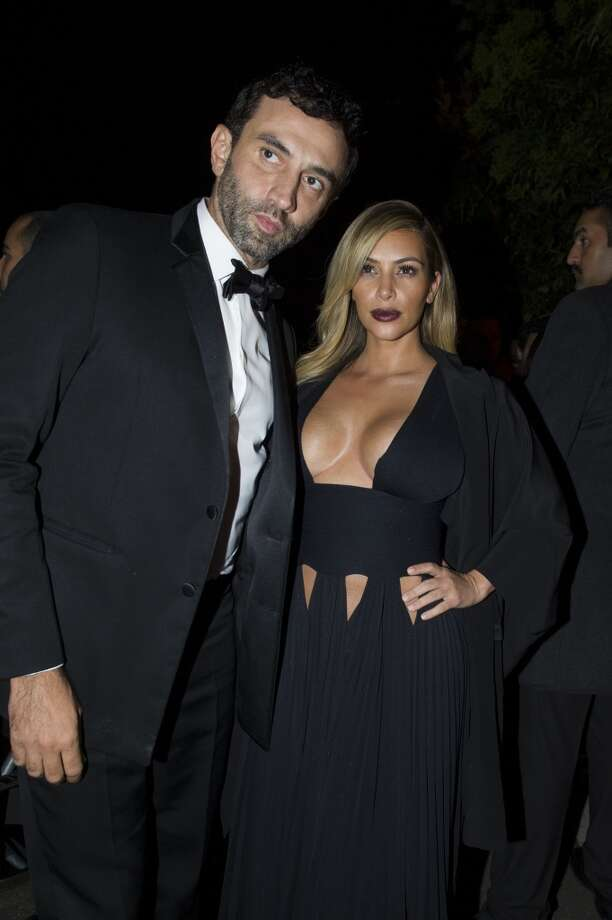 Kim Kardashian and a unidentified friend are posing for the photographers as they arrive to attend the Mademoiselle C Fashion Week VIP Screening after party, in Paris, Tuesday, Oct.1, 2013. (AP Photo/Zacharie Scheurer) Photo: Zacharie Scheurer, Associated Press