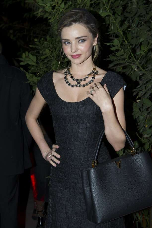Model Miranda Kerr poses for the photographers as she leaves the Mademoiselle C Fashion Week VIP Screening after party, in Paris, Tuesday, Oct.1, 2013. (AP Photo/Zacharie Scheurer) Photo: Zacharie Scheurer, Associated Press