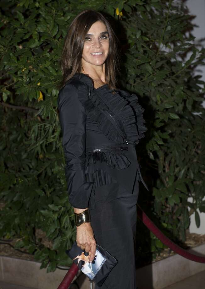 Carine Roitfeld poses as she arrives to attend the Mademoiselle C Fashion Week VIP Screening after party, in Paris, Tuesday, Oct.1, 2013. (AP Photo/Zacharie Scheurer) Photo: Zacharie Scheurer, Associated Press