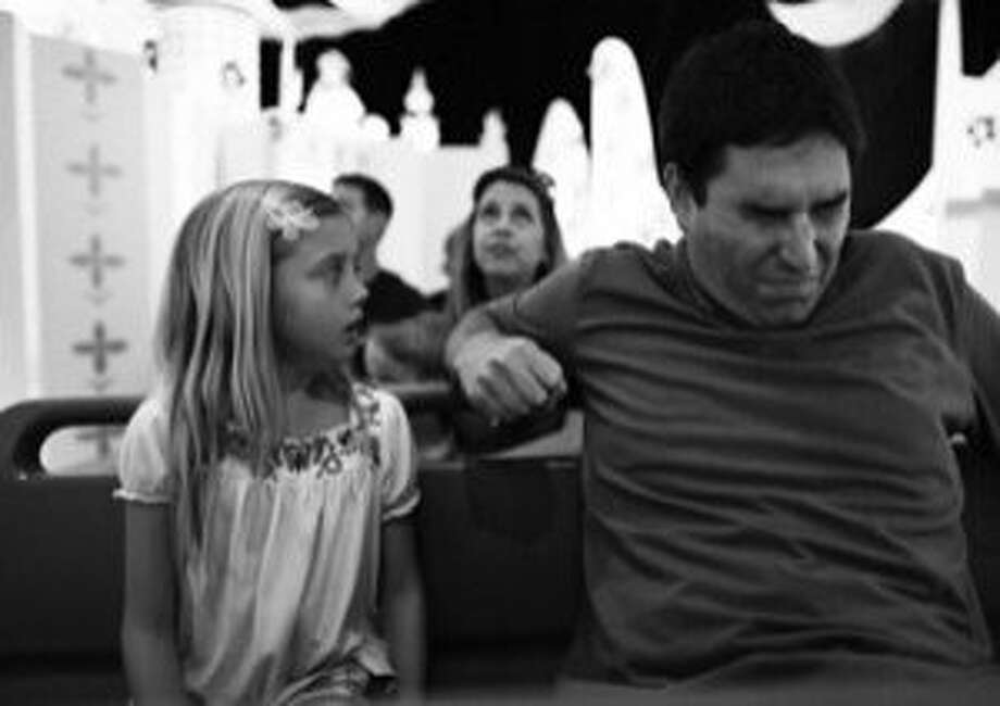 """Katelynn Rodriguez and Roy Abramsohn star in """"Escape From Tomorrow,"""" about a dad's nervous breakdown at Disney World. Photo: Mankurt Media"""