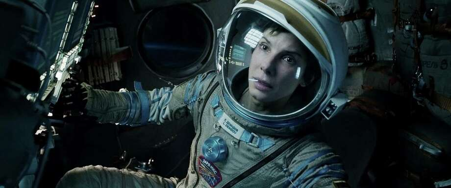 As Mission Specialist Ryan Stone, Sandra Bullock must convey warmth, relief, grief, regret and stark terror — and she delivers. Photo: Warner Bros. Pictures