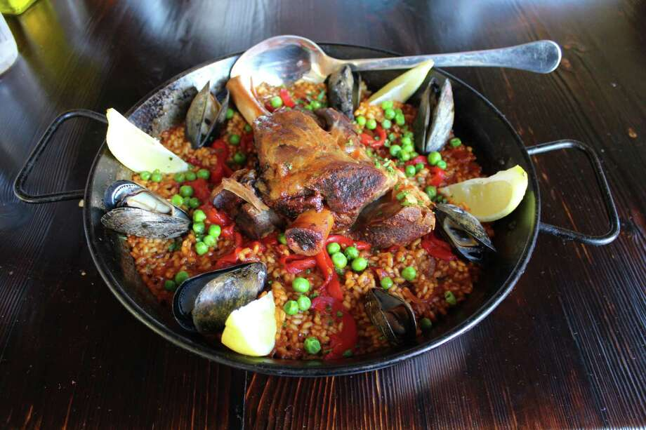 Paella at Barraca is made with roasted lamb shank, mussels and chorizo.