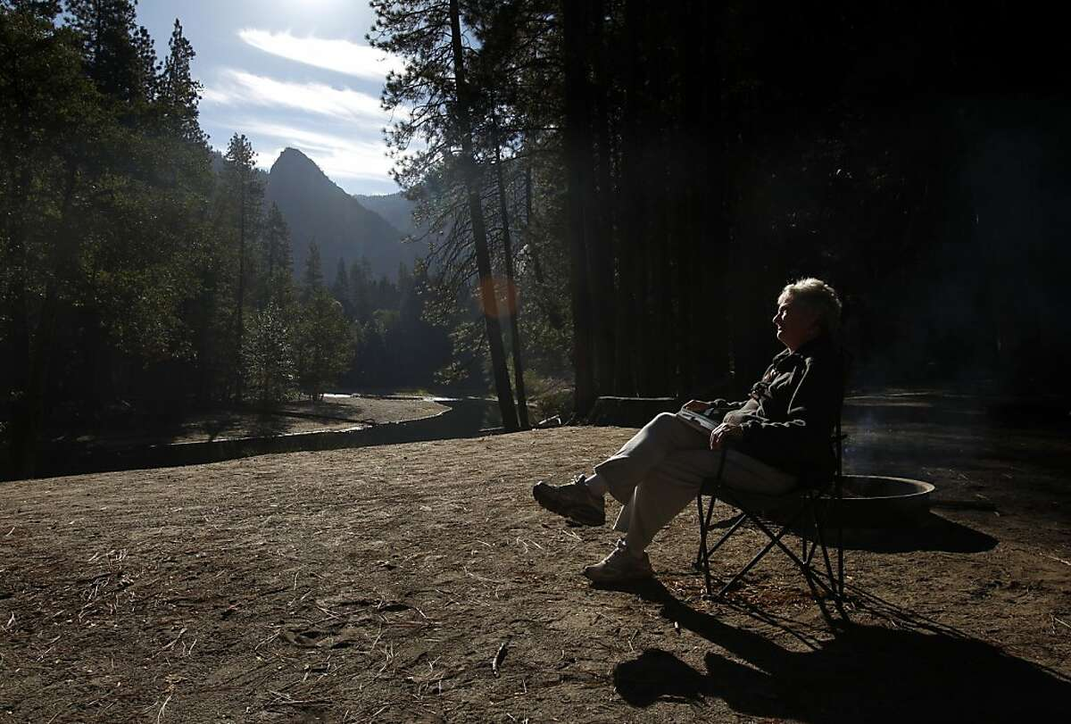 """Athene Mantle of San Jose enjoys rare quiet due to a lack of people at Housekeeping Camp October 2, 2013 at Yosemite National Park, Calif. Due to the Federal Government shutdown, the park is now closed to outside visitors. Mantle, who says she has been coming to the park since she was a year old says she can't ever remember it being so devoid of people. """"I was just enjoying the peace and quiet, which I will probably never see again in my lifetime,"""" she said. Mantle left a day early on Wednesday because everything she wanted to see in the park was closed. All park-goers must leave by noon Thursday, after which most of the DNC Parks & Resorts workers will be placed on unpaid """"on-call"""" status."""