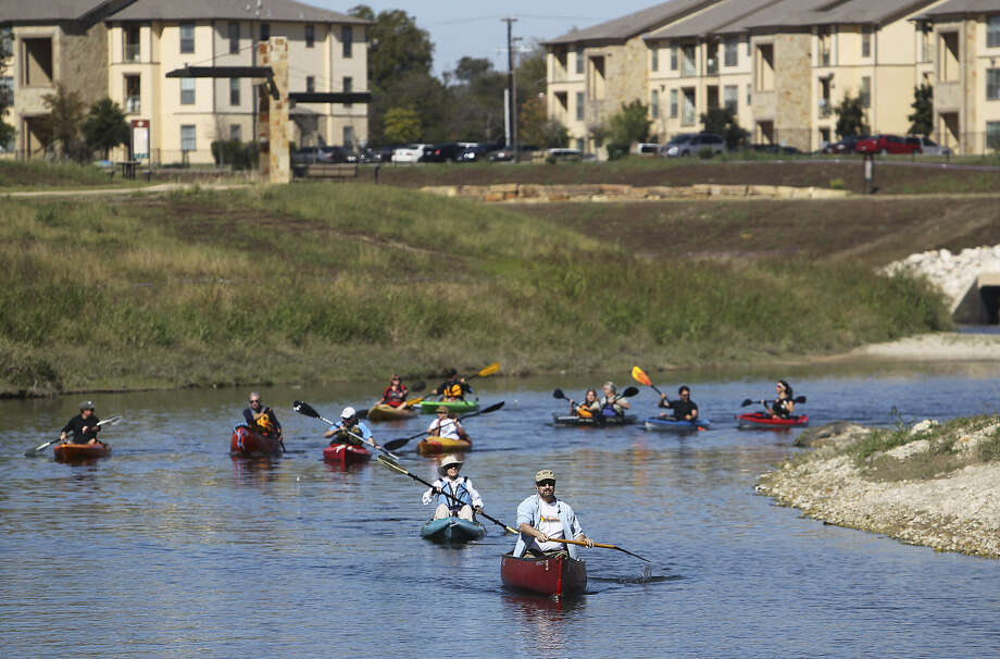 Groups of paddlers head downstream on the Mission Reach Paddling Trail along the San Antonio River near Mission County Park. The completed Mission Reach will celebrate its grand opening Saturday. Photo: Kin Man Hui / San Antonio Express-News
