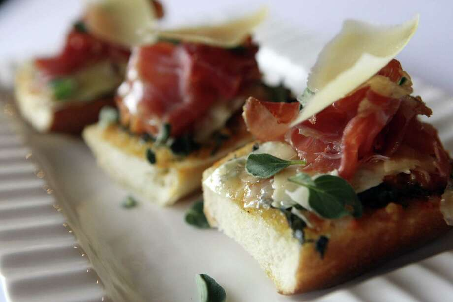 Puerto Banus crostini (left) is among small plates served at Bite. Photo: Express-News File Photo