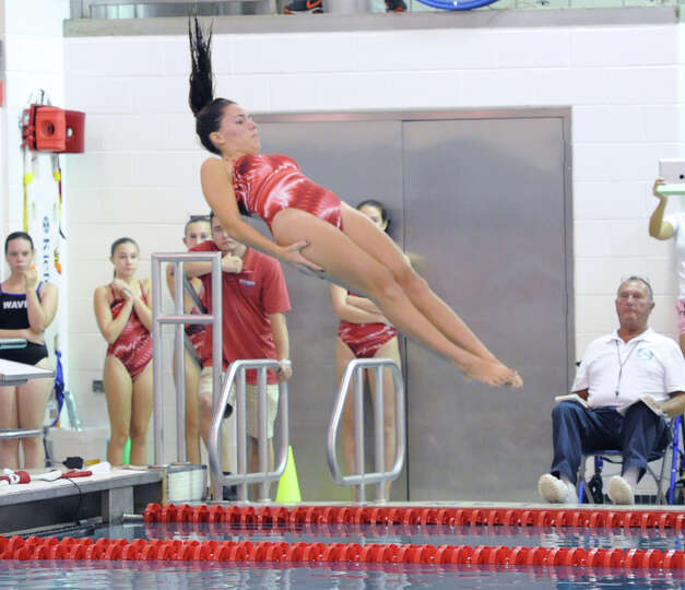 Greenwich High School diver, Ines Villemure, in action during the girls high school swim meet betwee