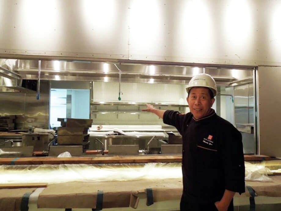 "Martin Yan shows off an exposition kitchen that will feature full view woks, ""flying noodles' that will be tossed 75 feet across a prep space, and ""interactive noodle dances"" with customers watching Dragon's Beard noodles hand pulled into 16,000 strands. Sonoma specialties will include Dungeness crab, alligator and crawfish dim sum, plus gluten free options."