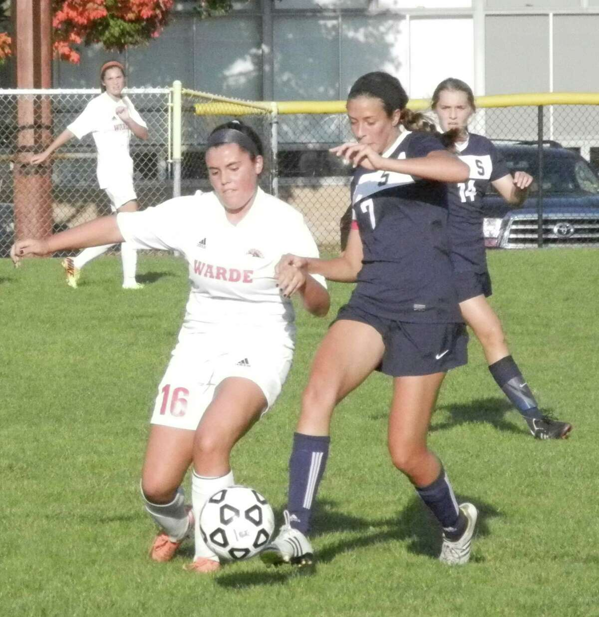 Fairfield Warde's Jenny Pullen (16) tangles with Staples Meghan Lonergan (7) in the Mustangs' 1-0 FCIAC girls soccer victory on Wednesday, Oct. 1 in Fairfield.