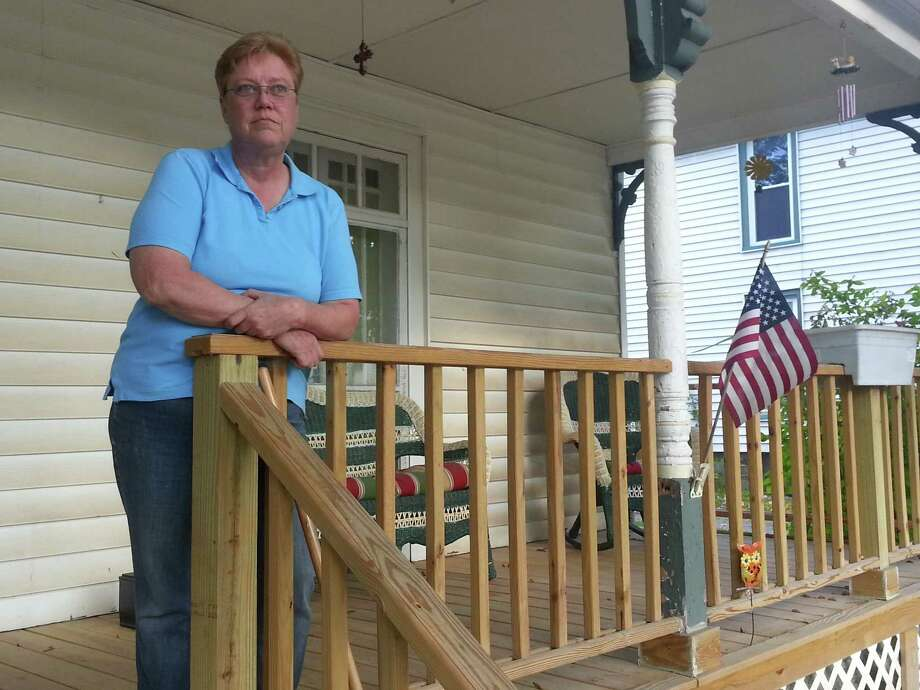 Anne McCormack's new porch was built without a permit after floodwaters from Tropical Storm Irene damaged her Middleburgh home. McCormack is now facing fines and even imprisonment for refusing to apply for a permit. (Photo by Chris Churchill / Times Union)