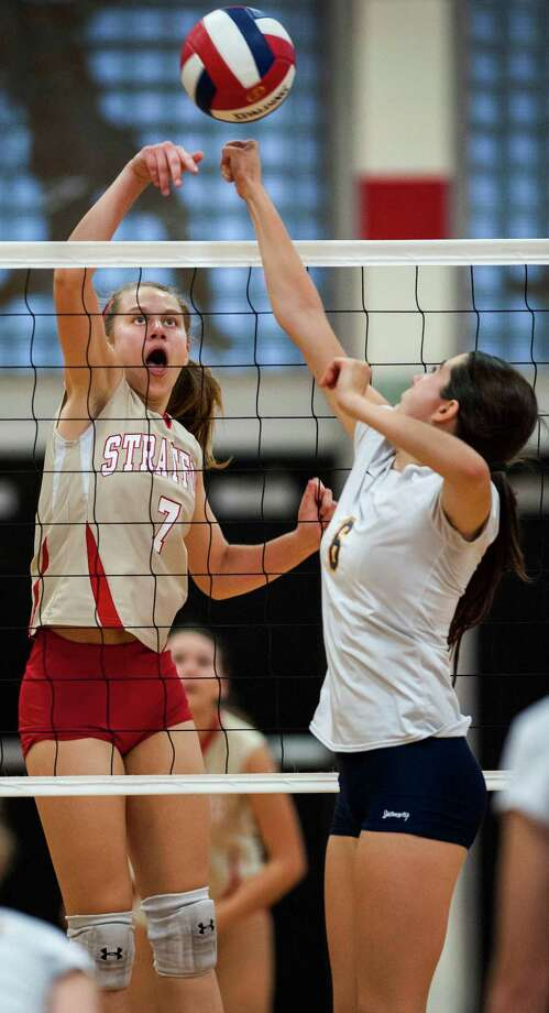 Stratford high school's Rachel Santo goes up for the ball at the net during a girls volleyball match against Weston high school played at Stratford high school, Stratford, CT on Wednesday, October, 2nd, 2013. Photo: Mark Conrad / Connecticut Post Freelance
