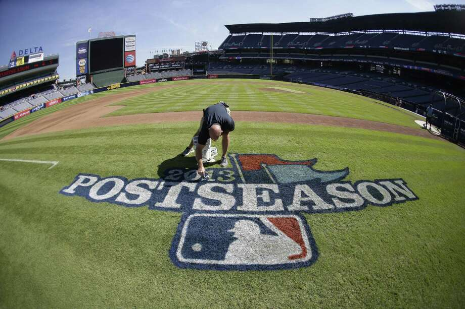 Field director Ed Mangan paints a postseason logo at Turner Field ahead of Thursday's Game 1 between the Braves and Dodgers in Atlanta. Both teams reached the playoffs with little stress over the final month. Photo: John Bazemore / Associated Press