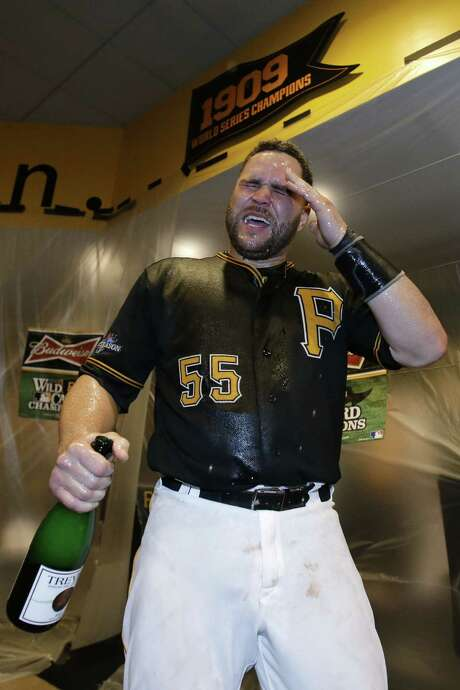Russell Martin got a champagne shower after helping the Pirates earn a date with the Cards. Photo: Gene J. Puskar / Associated Press