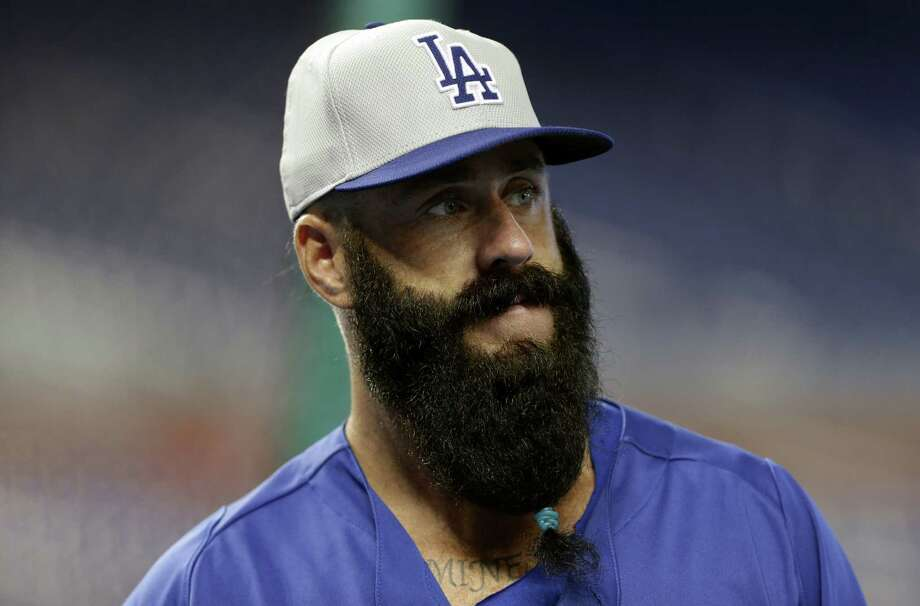Dodgers relief pitcher Brian Wilson has among the wildest of baseball beards, which have caught on among several teams in the postseason. Photo: Lynne Sladky / Associated Press