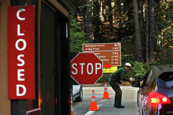 Law Enforcement Ranger Jeffrey Gardner tells motorists about the closure at Yosemite National Park due to the government shutdown.