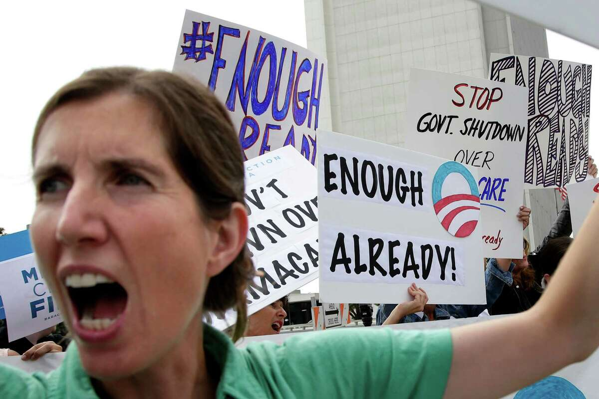 Vicki Maturo, of Culver City, Calif., chants during a protest against the government shutdown outside the federal building in Los Angeles on Wednesday, Oct. 2, 2013. President Barack Obama summoned congressional leaders to the White House on the second day of a partial government shutdown that has furloughed hundreds of thousands of workers and closed military cemeteries as far away as France. (AP Photo/Jae C. Hong)
