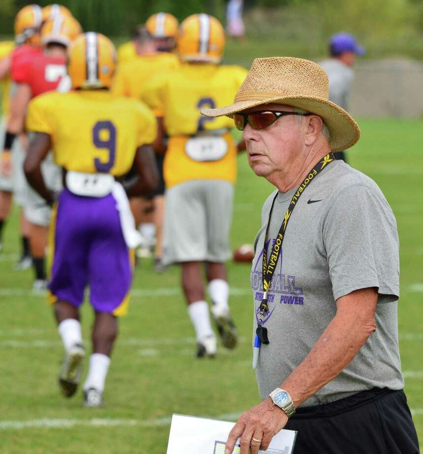 UAlbany head coach Bob Ford oversees football practice Thursday Aug. 29, 2013, in Albany, NY.  UAlbany's new  Bob Ford Field in background.  (John Carl D'Annibale / Times Union) Photo: John Carl D'Annibale / 00023689A