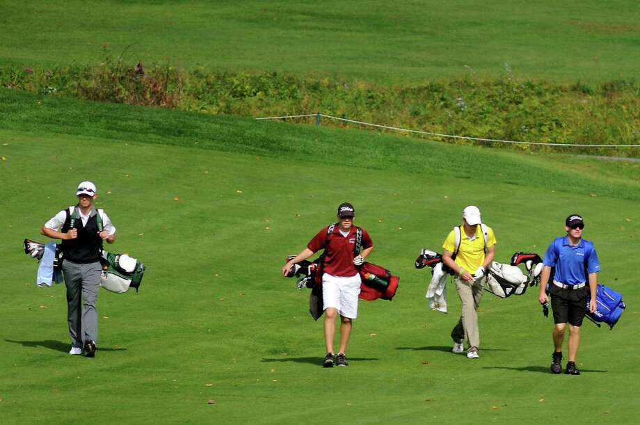 Competitors walk the seventh green during the Section II Class B golf championship on Wednesday, Oct. 2, 2013, at the Ballston Spa Country Club in Ballston Spa, N.Y. From left are Hudson Falls' Wyatt Gorham, Scotia's David Renko, Gloversville's Josh Fonda and South Glens Falls' Clark Leonelli. (Cindy Schultz / Times Union) Photo: Cindy Schultz / 00024043B