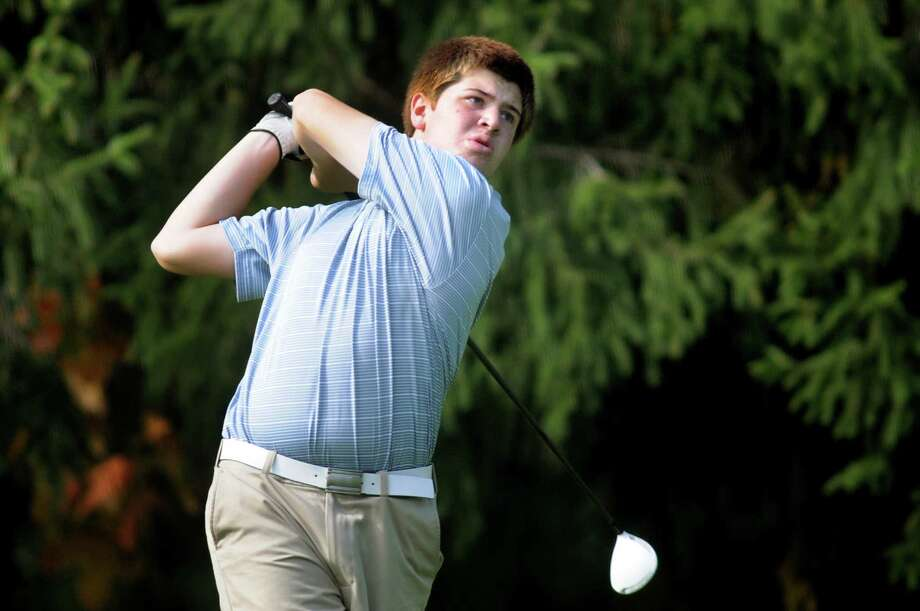 Ichabod Crane's Scott Vanderburgh drives off the fifth tee during the Section II Class B golf championship on Wednesday, Oct. 2, 2013, at the Ballston Spa Country Club in Ballston Spa, N.Y. (Cindy Schultz / Times Union) Photo: Cindy Schultz / 00024043B