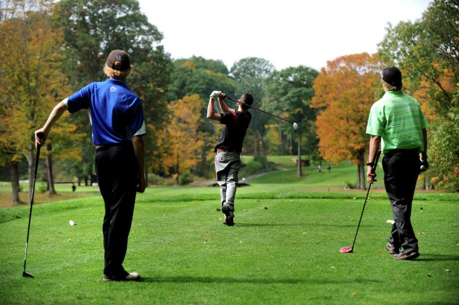 Tamarac's Anthony Giamei, center, drives off the twelfth tee during the Section II Class C and D golf championship on Wednesday, Oct. 2, 2013, at the Ballston Spa Country Club in Ballston Spa, N.Y. Looking on are Hoosick Falls' Eric Bloomer, left, and Greenville's Brenner Bachman. (Cindy Schultz / Times Union) Photo: Cindy Schultz / 00024043B