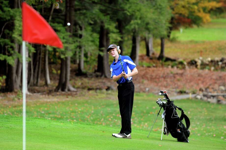 Hoosick Falls' Eric Bloomer chips onto the twelfth green during the Section II Class C and D golf championship on Wednesday, Oct. 2, 2013, at the Ballston Spa Country Club in Ballston Spa, N.Y. (Cindy Schultz / Times Union) Photo: Cindy Schultz / 00024043B