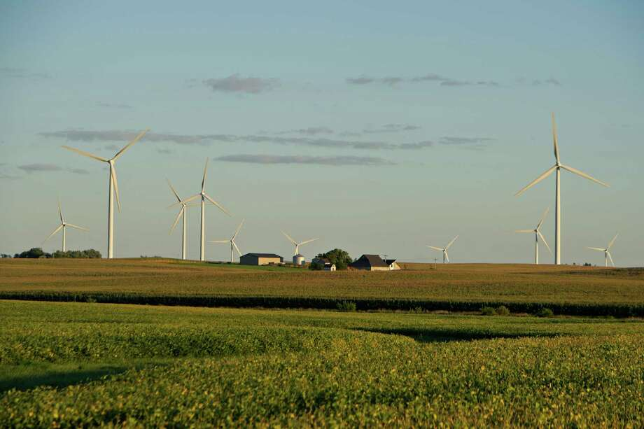Turbines work near Tiskilwa, Ill. The president wants an extension of a wind energy tax credit. Photo: Daniel Acker / © 2013 Bloomberg Finance LP