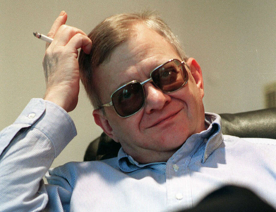 FILE - In this Feb. 4, 1998 file photo, writer Tom Clancy appears at his home in Calvert County, Md. Clancy, the estselling author of more than 25 fiction and nonfiction books for the Penguin Group, died on Oct. 1, 2013 in Baltimore, Md. He was 66.  (AP Photo/Vince Lupo) ORG XMIT: NYET301 Photo: VINCE LUPO / AP