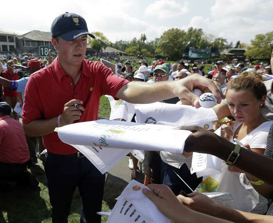 Former University of Texas standout Jordan Spieth hands out an autographed ball as he signs for fans in Dublin, Ohio. Photo: Darron Cummings / Associated Press