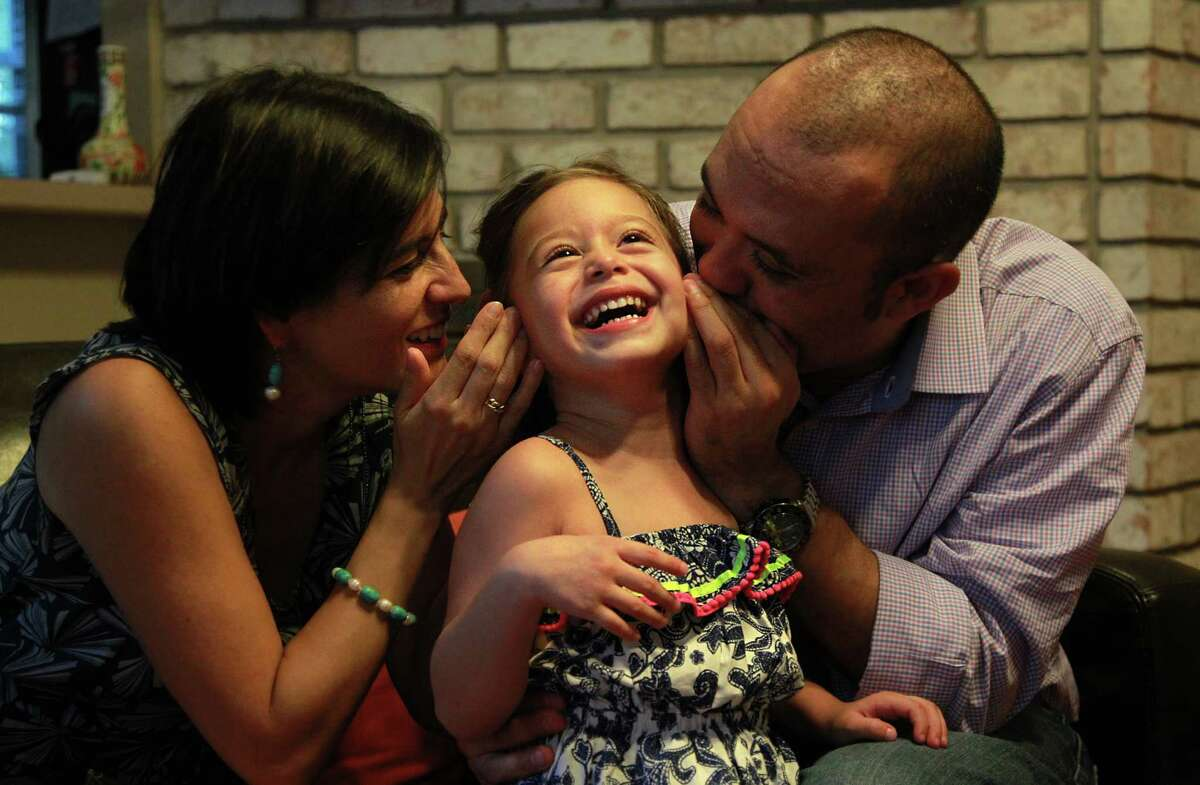 """Sofia Reyes, with parents Sandra Ojeda and Juan Reyes, is an """"entirely different girl"""" since her diagnosis, her mother says."""