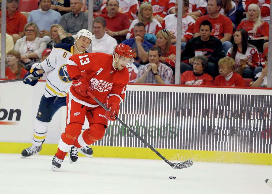DETROIT, MI - OCTOBER 02: Pavel Datsyuk #13 of the Detroit Red Wings skates past Cody McCormick #8 of the Buffalo Sabres in the second period at Joe Louis Arena on October 2, 2013 in Detroit, Michigan. (Photo by Gregory Shamus/Getty Images) ORG XMIT: 181107432 Photo: Gregory Shamus / 2013 Getty images
