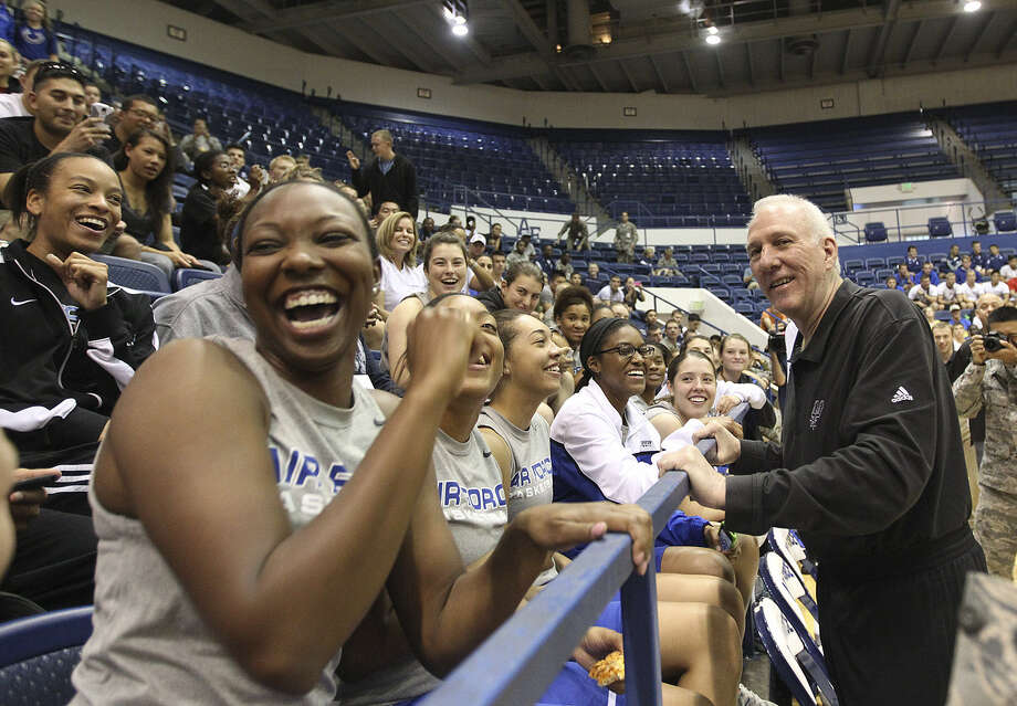 Spurs coach Gregg Popovich draws a laugh from the Air Force women's basketball team before practice at Clune Arena. Photo: Jerry Lara / San Antonio Express-News