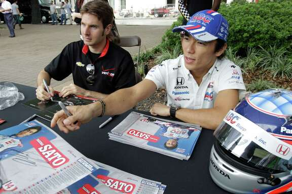 Will Power, left, an established IndyCar driver, and Takuma Sato, a first-time winner this season, sign autographs outside City Hall on Wednesday. For more Grand Prix of Houston photos throughout the weekend, go to chron.com/grandprix.