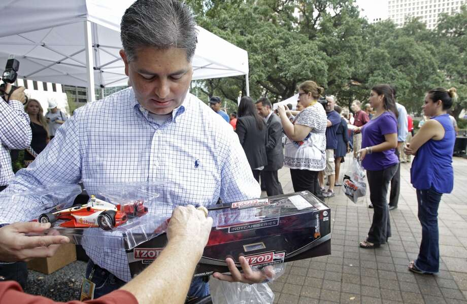 Frank Contreras puts an Indycar model back into box after having it autographed by Indycar driver Helio Castroneves during a Grand Prix of Houston event outside of City Hall Wednesday, Oct. 2, 2013, in Houston. During the event Mayor Annise Parker officially proclaimed the day as Shell and Pennzoil Grand Prix of Houston Day. ( Melissa Phillip / Houston Chronicle ) Photo: Houston Chronicle