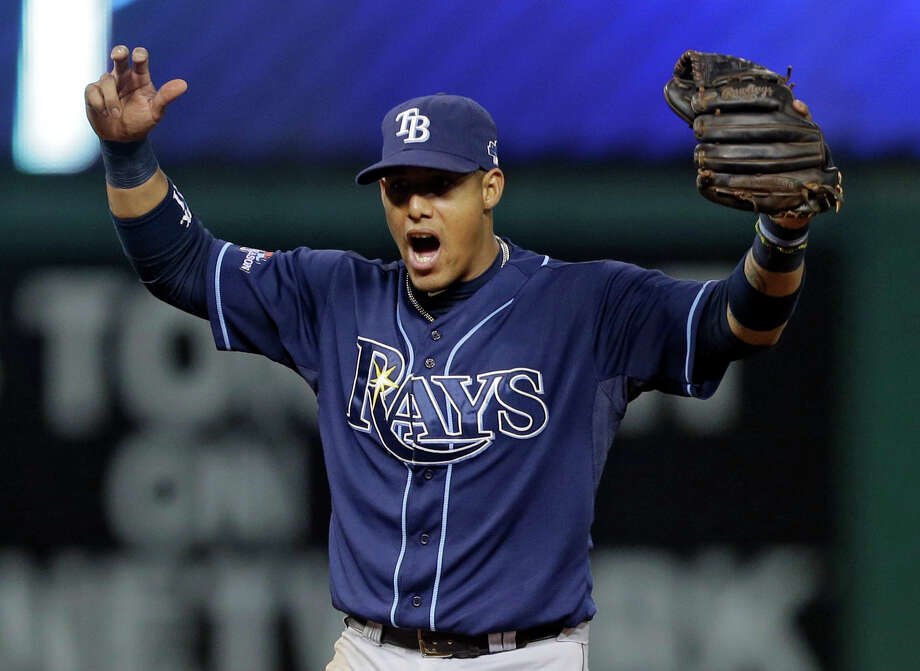 Tampa Bay Rays shortstop Yunel Escobar celebrates after completing a bases-loaded double play against the Cleveland Indians to end the fourth inning in the AL wild-card baseball game Wednesday, Oct. 2, 2013, in Cleveland. (AP Photo/Tony Dejak) ORG XMIT: CDB116 Photo: Tony Dejak / AP