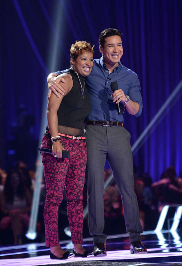 THE X FACTOR: FOUR CHAIR CHALLENGE: Contestant Lori (L) Moore and Mario Lopez (R) at the FOUR CHAIR CHALLENGE on THE X FACTOR airing Wednesday, Oct. 2 (8:00-10:00 PM ET/PT) on FOX.  CR: Michael Becker / FOX. © Copyright 2013 FOX Braodcasting.