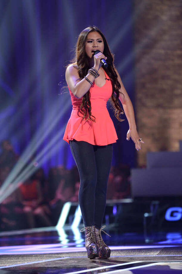 THE X FACTOR: FOUR CHAIR CHALLENGE: Contestant Ellona Santiago performs at the FOUR CHAIR CHALLENGE on THE X FACTOR airing Wednesday, Oct. 2 (8:00-10:00 PM ET/PT) on FOX.  CR: Michael Becker / FOX. © Copyright 2013 FOX Braodcasting.