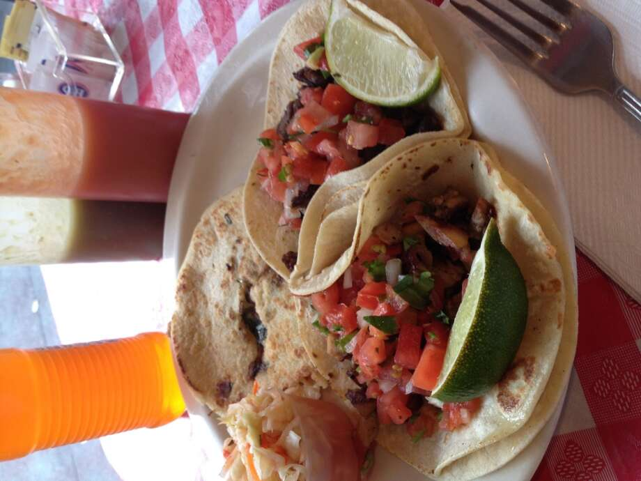 Guanaco's Tacos PupuseriaEveryone comes to this friendly Salvadoran place for its pupusas – thick, handmade corn tortillas filled with meat and cheese. The tacos on the menu don't stand out as much, but are filling and come with pico de gallo and salsa verde. Plus, you can order fried plantains, empanadas and pickled cabbage (curtido). 4106 Brooklyn Ave. NE, University District. Photo: Horace
