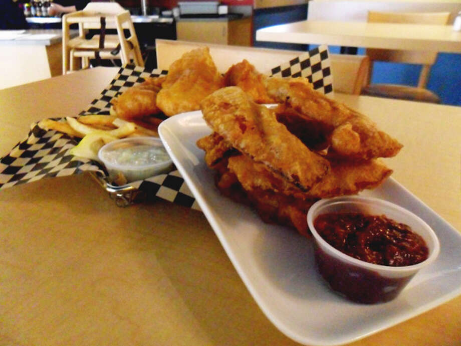 6. Fish Fish Bistro: This newish Capitol Hill place aims to have five kinds of fish everyday. It features fried pickles with chili mayo, tempura fried bacon with maple BBQ sauce, and, of course, fish and chips. Photo by Charlette Report.