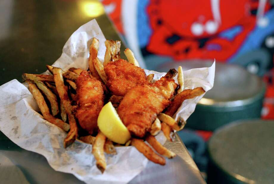 12. Jack's Fish Spot: Yelp reviewers say this Pike Place Market counter spot isn't the best or cleanest (and they grouse about the Kraft-packaged tartar sauce), but people-watching here is unbeatable. Photo: ANDY ROGERS, SEATTLE POST-INTELLIGENCER / Seattle Post-Intelligencer