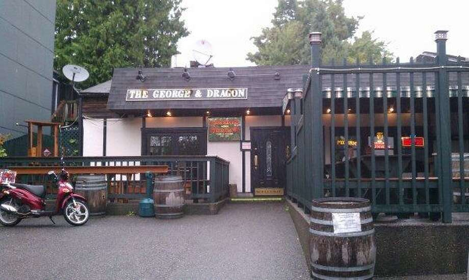 "18. The George & Dragon Pub: Since fish and chips began as a working-class English meal, go authentic with a basket at this British pub, while watching football on the ""telly."" Photo: Amy Rolph, Seattlepi.com"